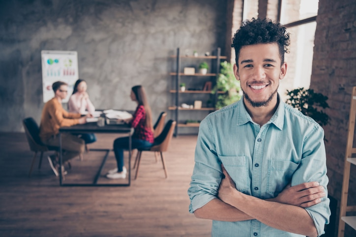 Portrait of nice attractive content cheerful guy shark hr director executive manager wearing blue shirt folded arms career development table at industrial loft interior workplace workstation